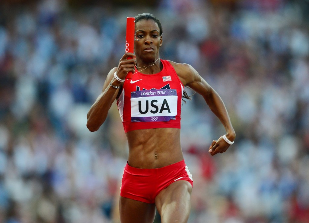 US' Deedee Trotter runs with the baton d